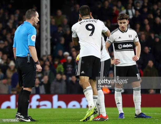 Aleksandar Mitrovic of Fulham kisses Aboubakar Kamara of Fulham before Aboubakar Kamara of Fulham takes the penalty and misses during the Premier...