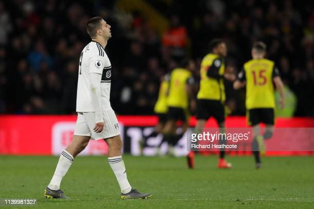 Aleksandar Mitrovic of Fulham looks dejected after his team concede a fourth goal during the Premier League match between Watford FC and Fulham FC at...