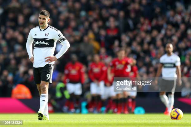 Aleksandar Mitrovic of Fulham looks dejected following Manchester United's second goal during the Premier League match between Fulham FC and...