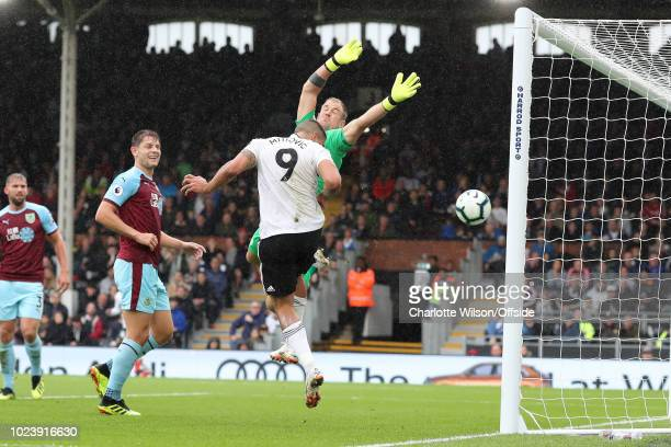 Aleksandar Mitrovic of Fulham puts the ball past Burnley goalkeeper Joe Hart to score their 2nd goal during the Premier League match between Fulham...