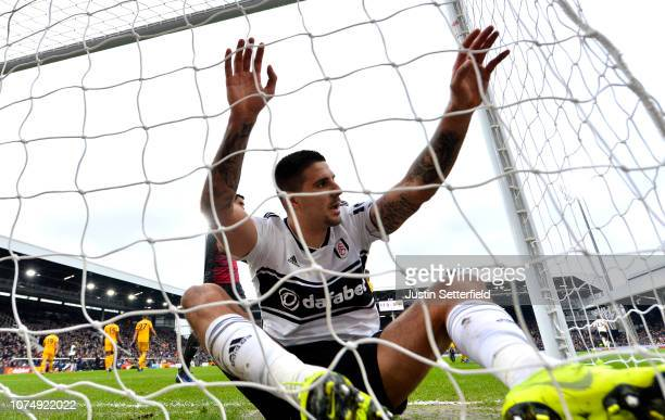 Aleksandar Mitrovic of Fulham reacts after falling into the net during the Premier League match between Fulham FC and Wolverhampton Wanderers at...