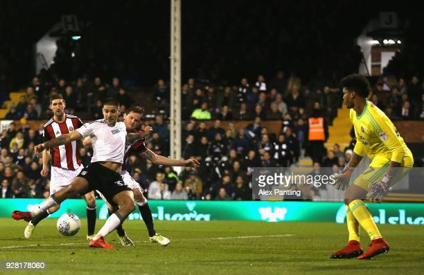 Aleksandar Mitrovic of Fulham scores his sides first goal during the Sky Bet Championship match between Fulham and Sheffield United at Craven Cottage...
