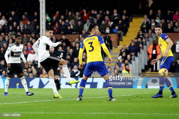 Aleksandar Mitrovic of Fulham scores his team's first goal during the Premier League match between Fulham FC and Southampton FC at Craven Cottage on...