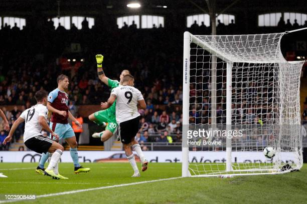 Aleksandar Mitrovic of Fulham scores his team's second goal during the Premier League match between Fulham FC and Burnley FC at Craven Cottage on...