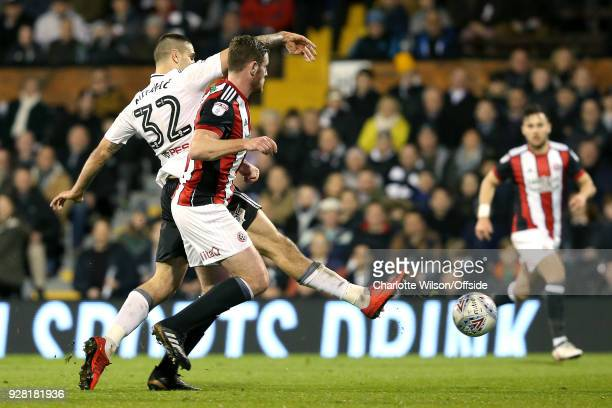 Aleksandar Mitrovic of Fulham scores their 2nd goal during the Sky Bet Championship match between Fulham and Sheffield United at Craven Cottage on...