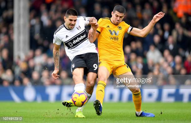 Aleksandar Mitrovic of Fulham shoots as he is challenged by Conor Coady of Wolverhampton Wanderers during the Premier League match between Fulham FC...