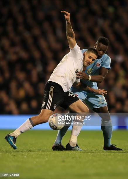 Aleksandar Mitrovic of Fulham tangles with Lamine Kone of Sunderland during the Sky Bet Championship match between Fulham and Sunderland at Craven...