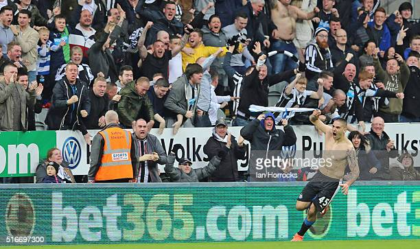 Aleksandar Mitrovic of Newcastle celebrates his goal by taking off his top during the Barclays Premier League match between Newcastle United FC and...