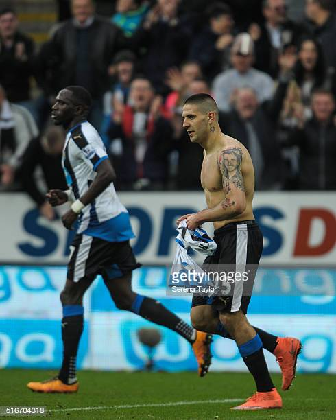 Aleksandar Mitrovic of Newcastle celebrates with his shirt off after scoring the equalising goal during the Premier League match between Newcastle...