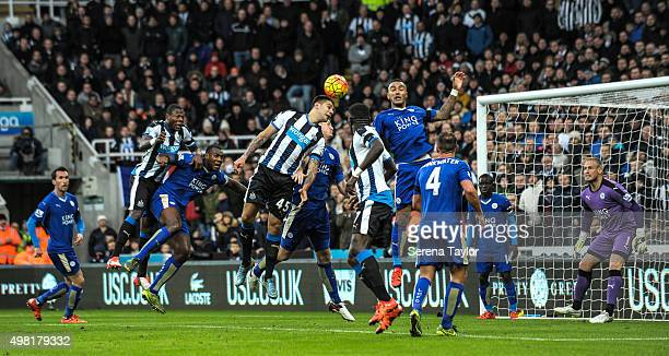 Aleksandar Mitrovic of Newcastle jumps in the air to head the ball from a corner during the Barclays Premier League match between Newcastle United...