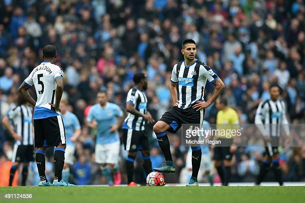Aleksandar Mitrovic of Newcastle looks dejected after the 4th Man City goal during the Barclays Premier League match between Manchester City and...