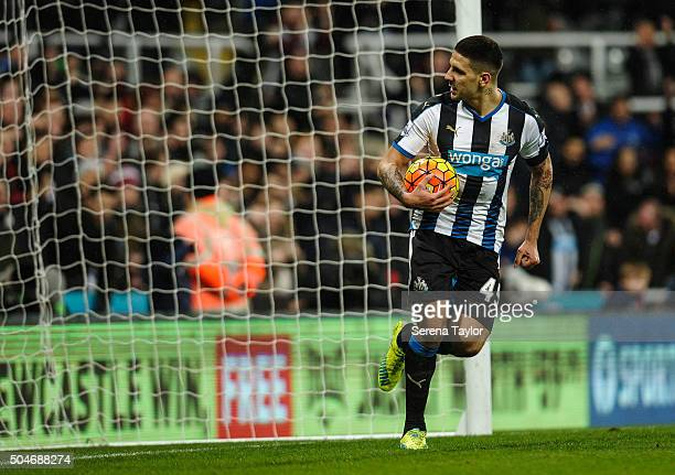 Aleksandar Mitrovic of Newcastle picks the ball out of the net after Georginio Wijnaldum scored Newcastle's goal during the Barclays Premier League...