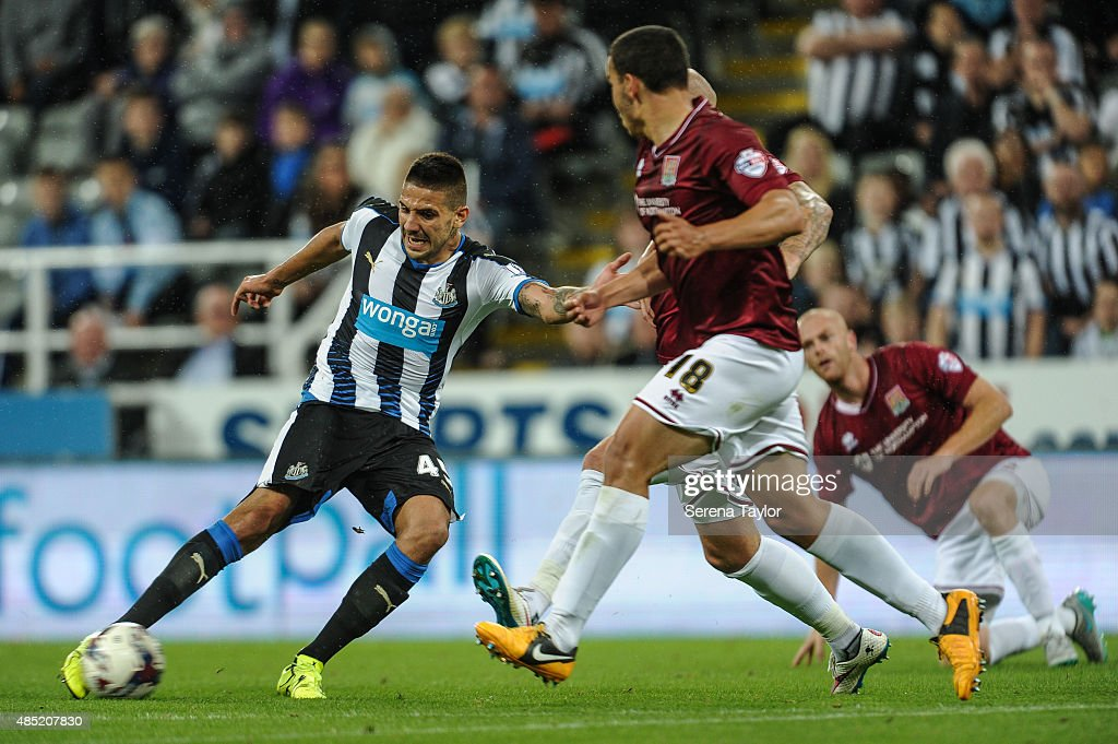 Aleksandar Mitrovic (L) of Newcastle strikes the ball during The Capital One Cup second round match between Newcastle United and Northampton Town at St.James Park on August 25, 2015, in Newcastle upon Tyne, England.