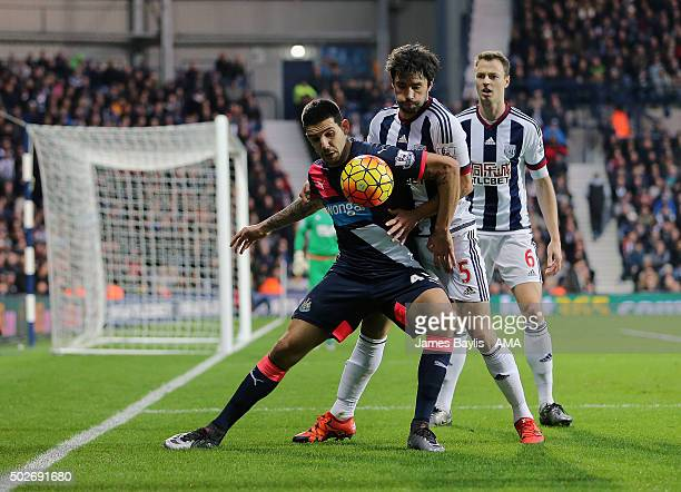 Aleksandar Mitrovic of Newcastle United and Claudio Yacob of West Bromwich Albion during the Barclays Premier League match between West Bromwich...