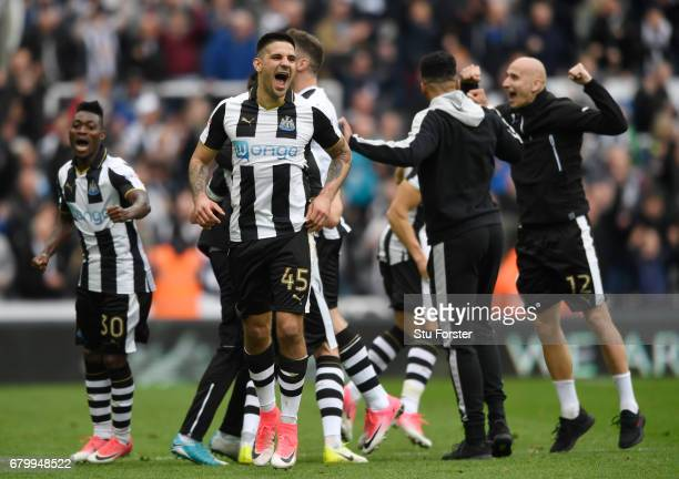 Aleksandar Mitrovic of Newcastle United and his Newcastle United team mates celebrate winning the title after the Sky Bet Championship match between...