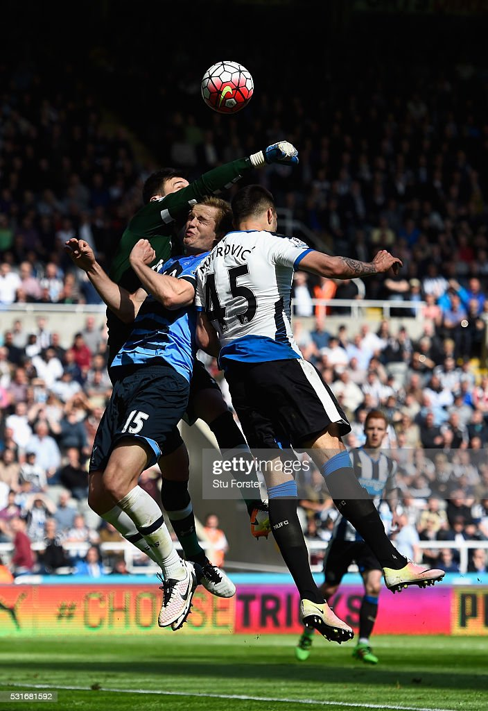 Aleksandar Mitrovic of Newcastle United and Hugo Lloris of Tottenham Hotspur compete for the with Eric Dier (c) during the Barclays Premier League match between Newcastle United and Tottenham Hotspur at St James' Park on May 15, 2016 in Newcastle, England.