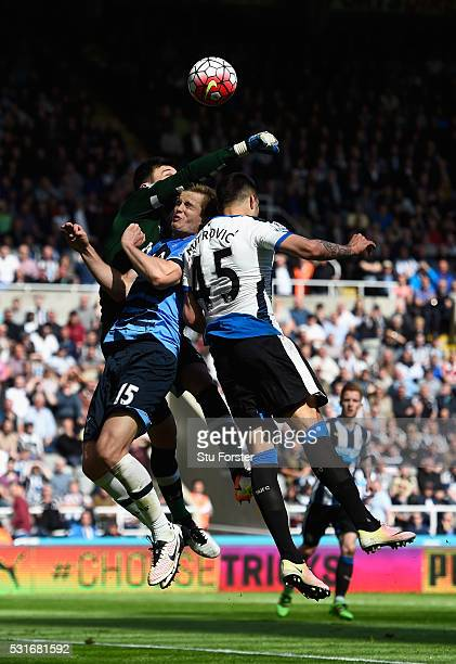 Aleksandar Mitrovic of Newcastle United and Hugo Lloris of Tottenham Hotspur compete for the with Eric Dier during the Barclays Premier League match...