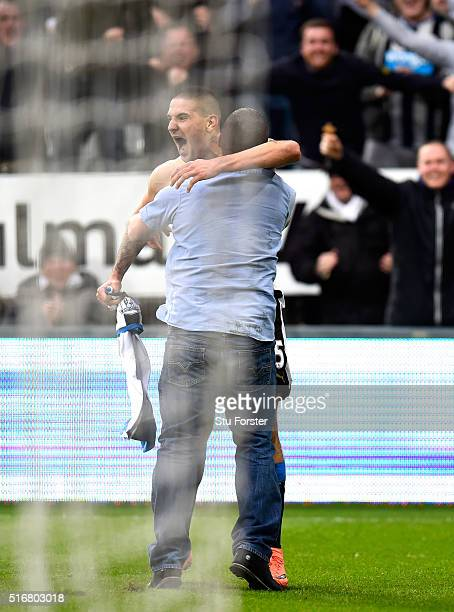 Aleksandar Mitrovic of Newcastle United ceebrates with a fan as he celebrates scoring their first and equalising goal during the Barclays Premier...