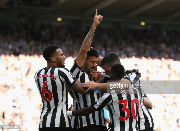 Aleksandar Mitrovic of Newcastle United celebrates scoring his sides third goal with his Newcastle United team mates during the Premier League match...