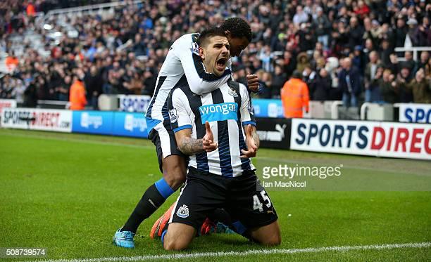 Aleksandar Mitrovic of Newcastle United celebrates scoring his team's first goal with his team mate Georginio Wijnaldum during the Barclays Premier...