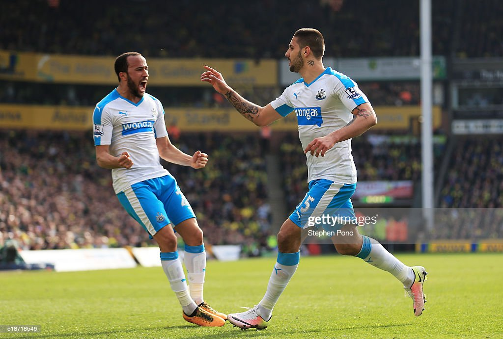 Aleksandar Mitrovic (R) of Newcastle United celebrates scoring his team's first goal with Andros Townsend (L) during the Barclays Premier League match between Norwich City and Newcastle United at Carrow Road on April 2, 2016 in Norwich, England.