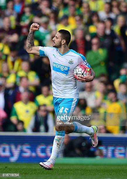 Aleksandar Mitrovic of Newcastle United celebrates scoring his team's second goal during the Barclays Premier League match between Norwich City and...