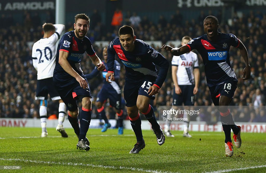Aleksandar Mitrovic of Newcastle United (C) celebrates with Paul Dummett (L) and Chancel Mbemba (R) as he scores their first and equalising goal during the Barclays Premier League match between Tottenham Hotspur and Newcastle United at White Hart Lane on December 13, 2015 in London, England.
