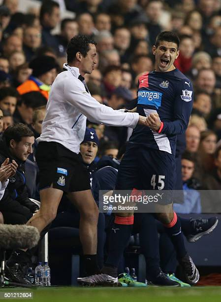Aleksandar Mitrovic of Newcastle United celebrates with team bench as he scores their first and equalising goal during the Barclays Premier League...