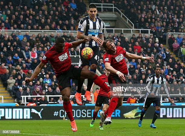 Aleksandar Mitrovic of Newcastle United competes for the ball against Victor Anichebe and Jonas Olsson of West Bromwich Albion during the Barclays...
