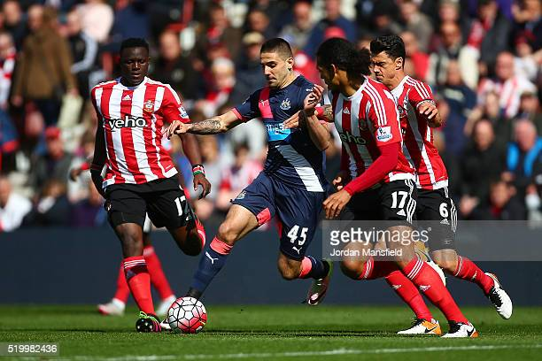 Aleksandar Mitrovic of Newcastle United controls the ball under pressure of Southampton defense during the Barclays Premier League match between...