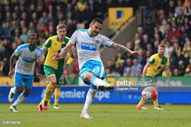Aleksandar Mitrovic of Newcastle United converts the penalty to score his team's second goal during the Barclays Premier League match between Norwich...