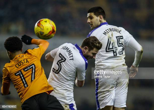 Aleksandar Mitrovic of Newcastle United heads the ball during the Sky Bet Championship match between Wolverhampton Wanderers and Newcastle United at...