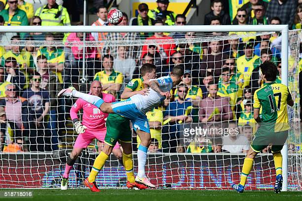 Aleksandar Mitrovic of Newcastle United heads the ball to score his team's first goal during the Barclays Premier League match between Norwich City...