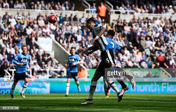 Aleksandar Mitrovic of Newcastle United heads the ball to score his team's second goal during the Barclays Premier League match between Newcastle...