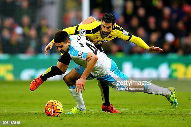 Aleksandar Mitrovic of Newcastle United is challenged by Miguel Angel Britos of Watford during the Barclays Premier League match between Watford and...