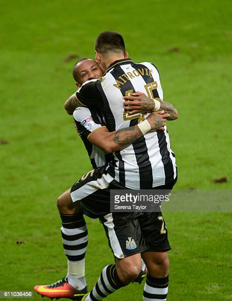 Aleksandar Mitrovic of Newcastle United jumps on top of Yoan Gouffran after Yoan scores the equalising goal during the Sky Bet Championship match...