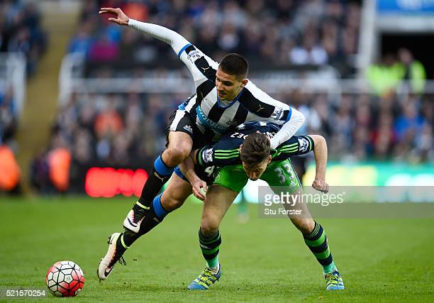 Aleksandar Mitrovic of Newcastle United makes a challenge on Federico Fernandez of Swansea City during the Barclays Premier League match between...