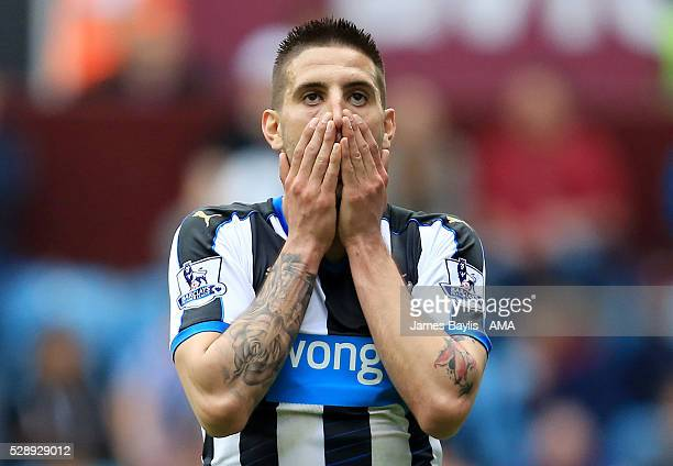 Aleksandar Mitrovic of Newcastle United reacts after missing a chance to score during the Barclays Premier League match between Aston Villa and...