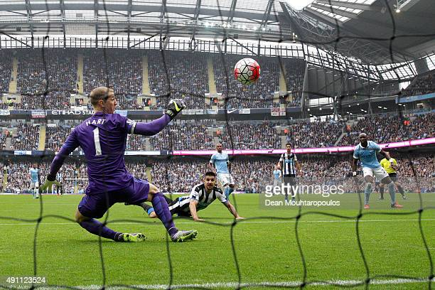Aleksandar Mitrovic of Newcastle United scores his team's first goal past Joe Hart of Manchester City during the Barclays Premier League match...