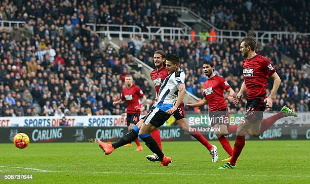 Aleksandar Mitrovic of Newcastle United scores his team's first goal during the Barclays Premier League match between Newcastle United and West...