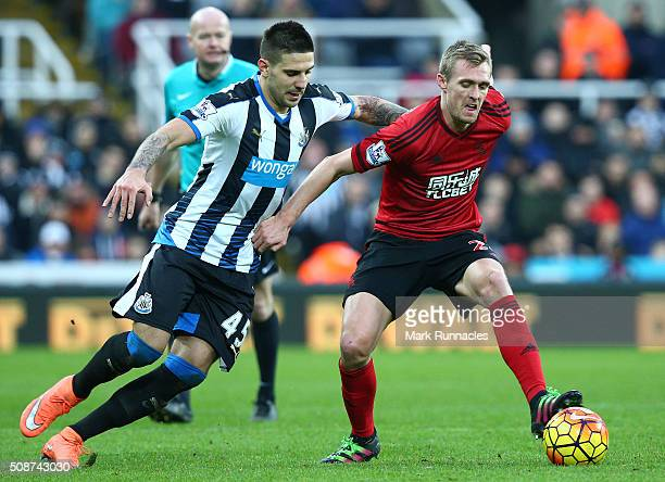 Aleksandar Mitrovic of Newcastle United tackles Darren Fletcher of West Bromwich Albion during the Barclays Premier League match between Newcastle...