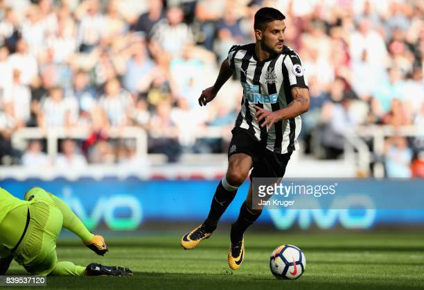 Aleksandar Mitrovic of Newcastle United takes the ball round the keeper to score his sides third goal during the Premier League match between...