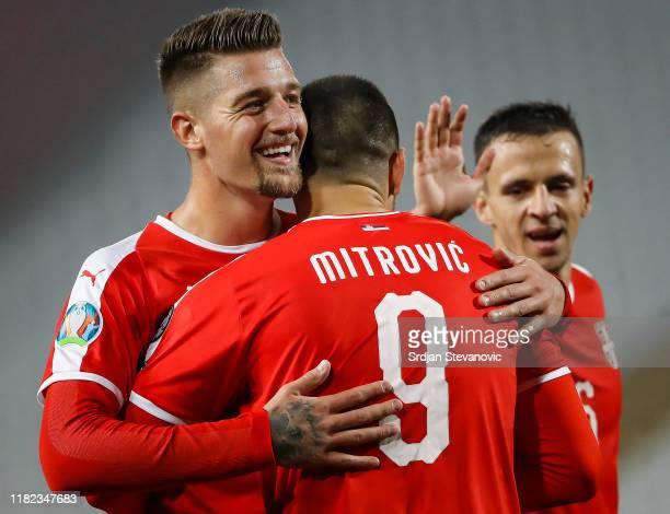 Aleksandar Mitrovic of Serbia celebrates after scoring a goal with Sergej MilinkovicSavic and Nemanja Maksimovic during the UEFA Euro 2020 Qualifier...