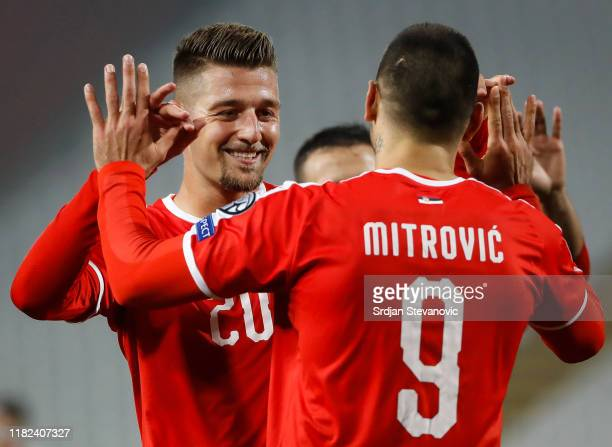 Aleksandar Mitrovic of Serbia celebrates after scoring a goal with Sergej Milinkovic-Savic during the UEFA Euro 2020 Qualifier Group B match between...