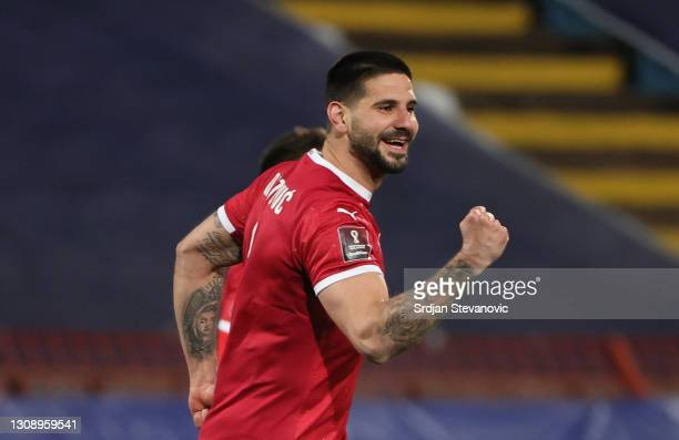 Aleksandar Mitrovic of Serbia celebrates after scoring his sides second goal during the FIFA World Cup 2022 Qatar qualifying match between Serbia and...