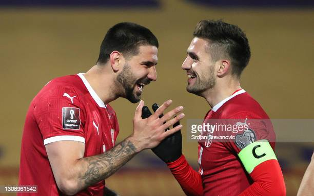 Aleksandar Mitrovic of Serbia celebrates after scoring his sides third goal with teammate Dusan Tadic during the FIFA World Cup 2022 Qatar qualifying...