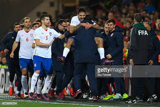 Aleksandar Mitrovic of Serbia celebrates scoring his team's first goal with his teammates during the FIFA 2018 World Cup Qualifier between Wales and...