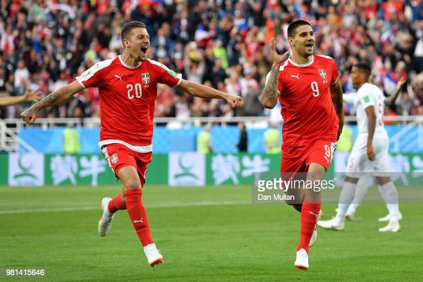Aleksandar Mitrovic of Serbia celebrates with Sergej MilinkovicSavic after scoring his team's first goal during the 2018 FIFA World Cup Russia group...