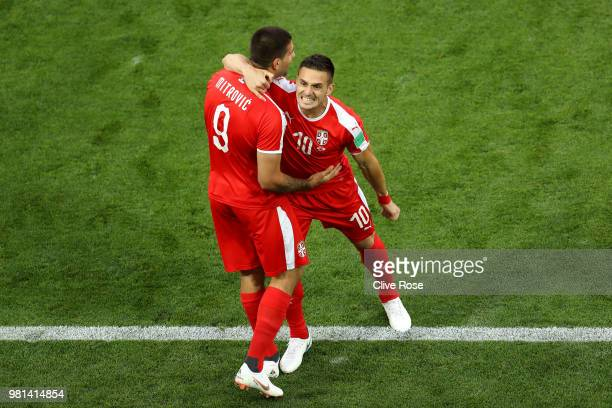 Aleksandar Mitrovic of Serbia celebrates with teammate Dusan Tadic after scoring his team's first goal during the 2018 FIFA World Cup Russia group E...