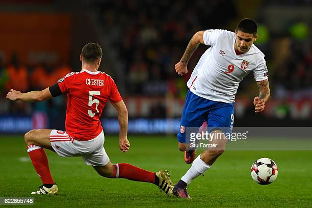 Aleksandar Mitrovic of Serbia goes past James Chester of Wales during the FIFA 2018 World Cup Qualifier between Wales and Serbia at Cardiff City...